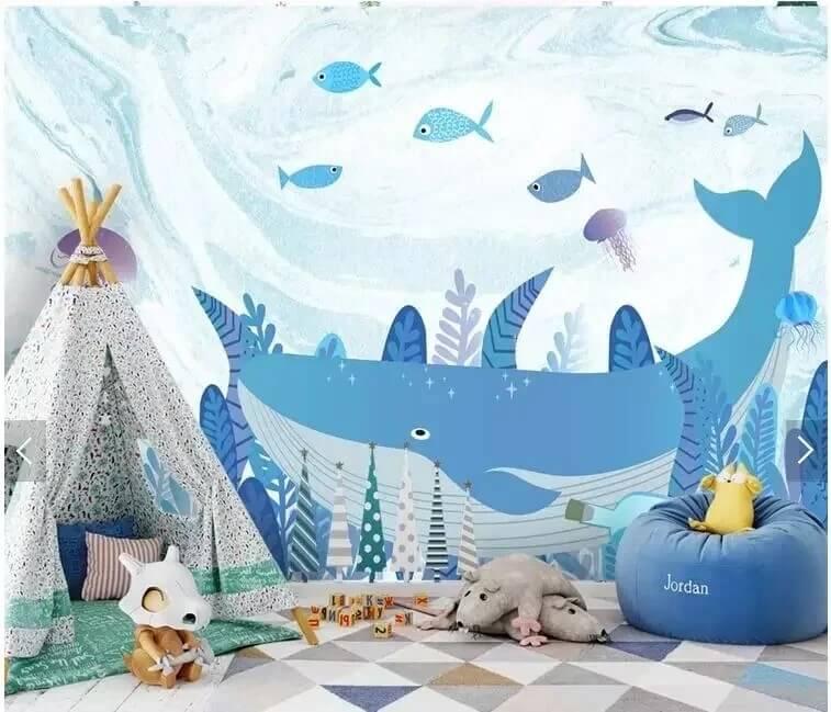 Хорошим вариантом оформления дизайна детской комнаты являются обои с китами на стену. Такое, немного сказочное изображение позволит развиваться фантазии Вашего ребенка, мечтать о путешествиях и познании мира. Используются мягкие, подобранные друг к другу цвета, которые не раздражают глаза.