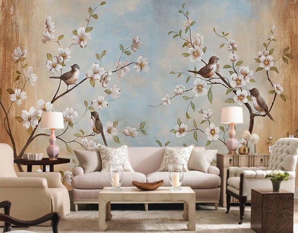 Необычные фотообои с птицами сидящими на ветках деревьев внесут в вашу гостинную уют и спокойствие